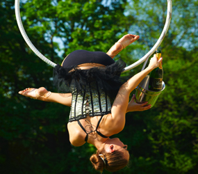 SUMMER GARDEN ACTS AERIAL CHAMPAGNE SERVICE PERFECT LUXURY ENTERTAINMENT FOR GARDEN PARTIES AND WEDDINGS