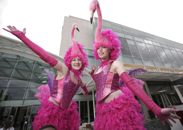 alice in wonderland themed stilt acts - the flamingos -bristol london and manchester