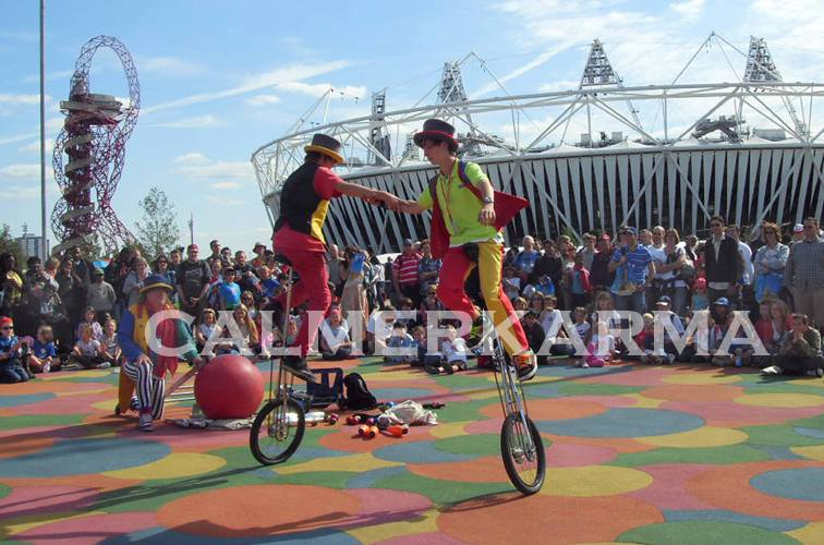 BEST OF BRITISH THEMED ENTERTAINMENT -UNICYCLISTS AT OLYMPIC PARK -LONDON 2012