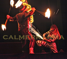 circus themed staged fire show with angle grinding zebra