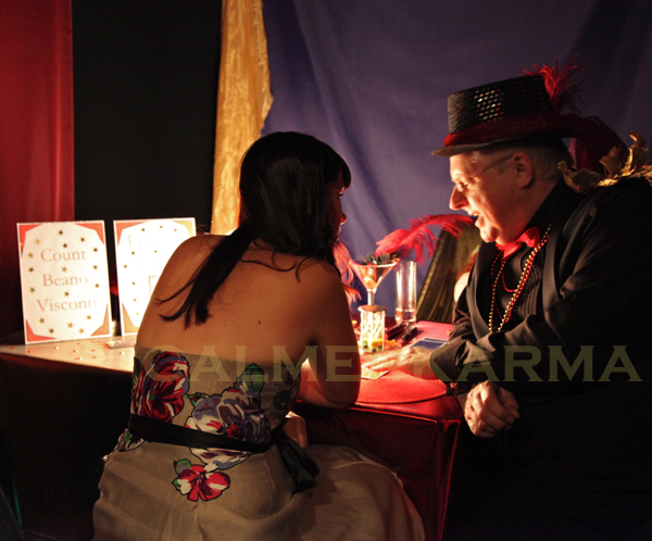 FORTUNE TELLING FOR EVENTS- MOULIN ROUGE THEMED FEATHER READER UK
