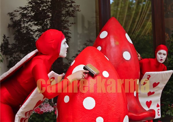 ALICE IN WONDERLAND THEMED ACTS TO HIRE - RED CARD COMICAL WALKABOUT ACTs to hire - LONDON