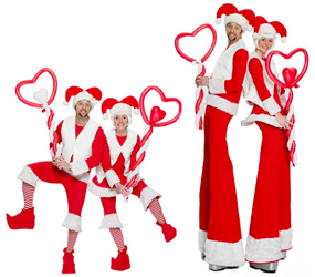 CHRISTMAS ENTERTAINMENT TO HIRE- SANTA STILTS AND ELF BALLOON MODELLERS BIRMINGHAM AND MANCHESTER AND LONDON