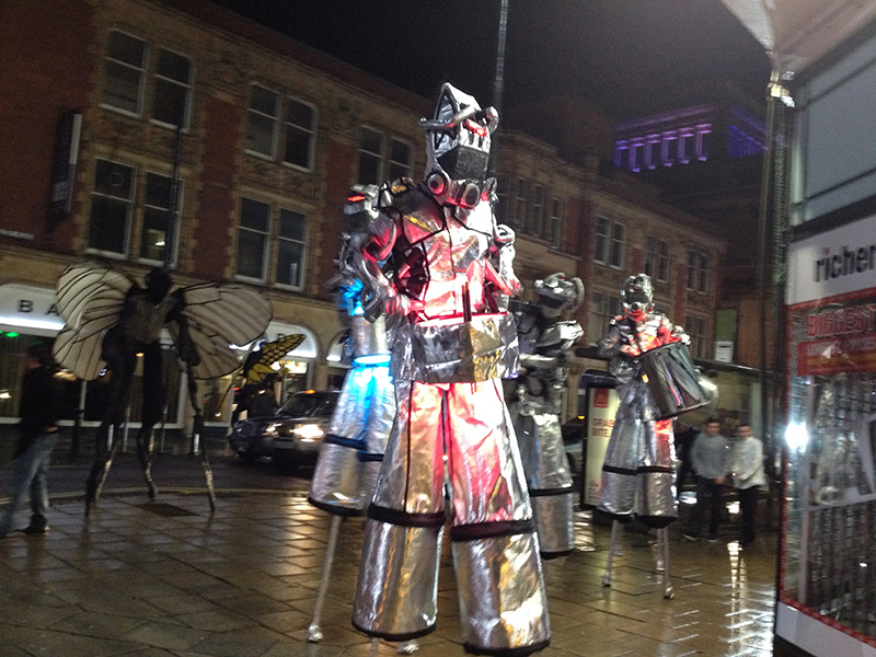 SPACE & SCI FI THEMED STILT WALKERS TO HIRE - UK - LED DRUMMER ANDROID STILTS