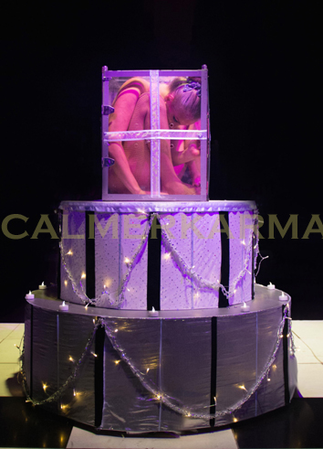 alice in wonderland themed acts to hire - dramatic contortion in a cake act -UK