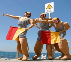 BEACH & SEASIDE THEMED ENTERTAINMENT - COMICAL LIFEGUARD STILTS HIRE