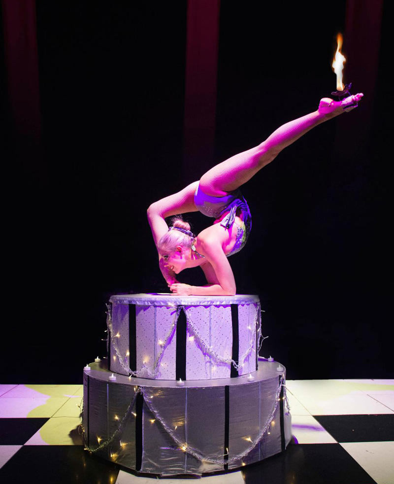 CAKE CONTORTION ACT WITH FIRE -STUNNING FOR BIRTHDAY PARTIES , ALICE IN WONDERLAND EVENTS AND CAKE CELEBRATION EVENTS