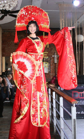 CHINESE NEW YEAR THEMED STILTS PERFECT FOR SHOPPING CENTRES OR PRODUCT LAUNCHES