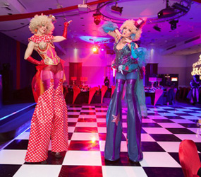 CIRCUS THEMED ENTERTAINMENT - CLOWN GIRL STILTS- GREATEST SHOWMAN ACTS TO HIRE - UK