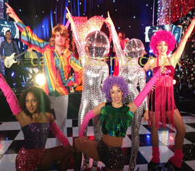 DISCO & STUDIO 54 THEMED ENTERTAINMENT PACKAGES DISCO BANDS, DISCO DANCERS ROLLER SKATERS jOHN TRAVOLTA HIRE