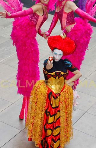 ALICE IN WONDERLAND AND THROUGH THE LOOKING GLASS THEMED ENTERTAINMENT -FLAMINGO STILTS AND RED QUEEN PERFORMER MANCHESTER + LONDON