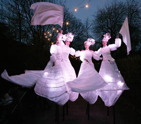 WINTER ILLUMINATE LIGHT STILT WALKER TROUPE
